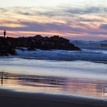Man On The Rocks Watching Sunset by Maureen Bates Photography